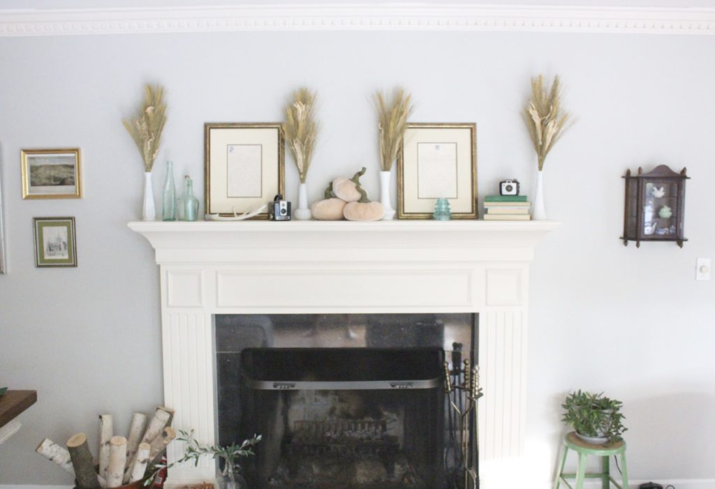 Transitional Fall Mantel- how to decorate the easy way for fall- mantel decor- mantles- decorating a fall mantel- autumn decor- decorating with wheat- pumpkins