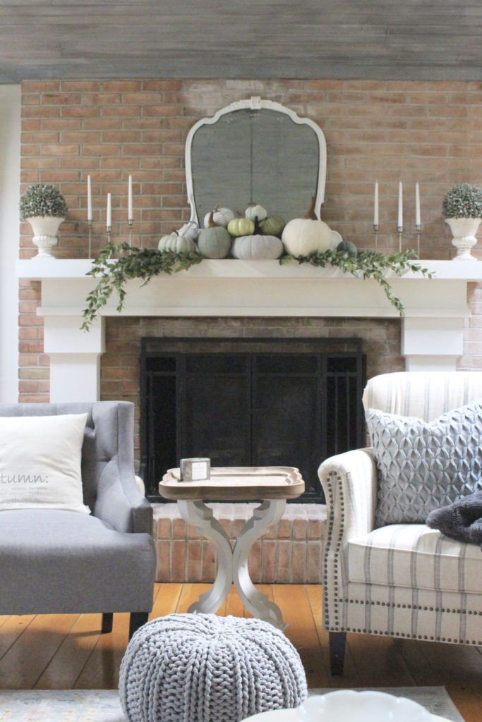 Decorating for fall with Subtle Colors- fall decor with pastel colors- pastel colors- green- gray for fall- living room fall decor- mantel decor for fall- subtle fall- simple fall decorations- pumpkin display on a mantel