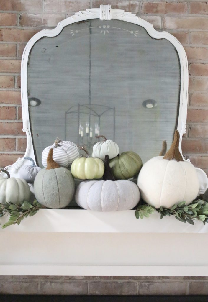 Decorating for fall with Subtle Colors- fall decor with pastel colors- pastel colors- green- gray for fall- living room fall decor- mantel decor for fall- subtle fall- simple fall decorations- pumpkins on display- wool pumpkins