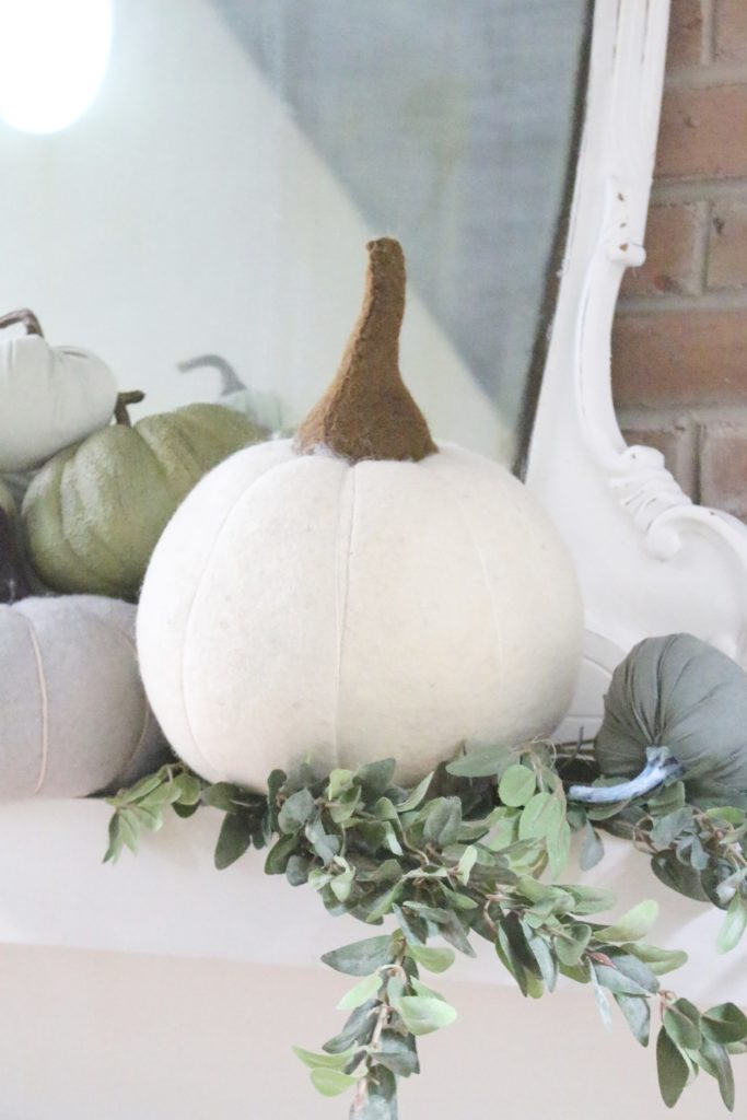 Decorating for fall with Subtle Colors- fall decor with pastel colors- pastel colors- green- gray for fall- living room fall decor- mantel decor for fall- subtle fall- simple fall decorations- wool pumpkins- pumpkin display
