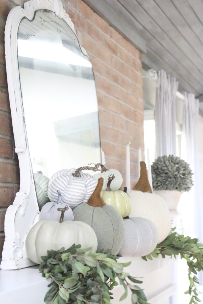 Decorating for fall with Subtle Colors- fall decor with pastel colors- pastel colors- green- gray for fall- living room fall decor- mantel decor for fall- subtle fall- simple fall decorations- displaying pumpkins on a mantel