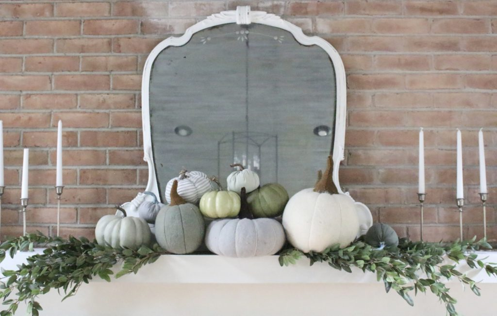 Decorating for fall with Subtle Colors- fall decor with pastel colors- pastel colors- green- gray for fall- living room fall decor- mantel decor for fall- subtle fall- simple fall decorations- pumpkins on display