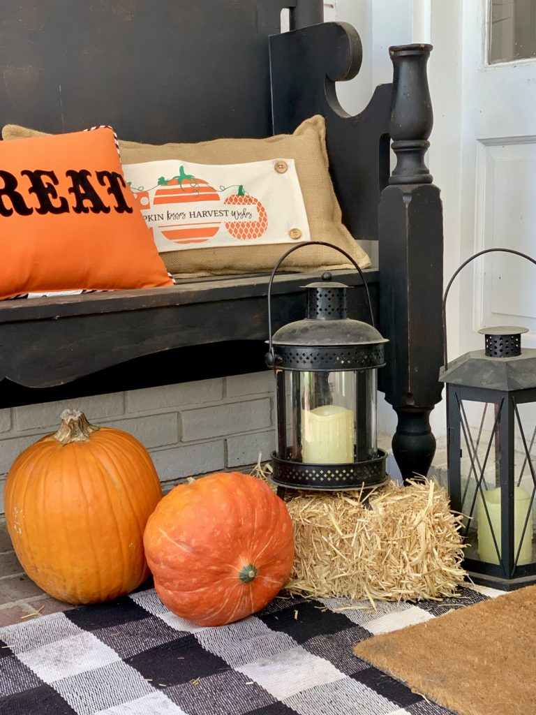 Fall Porch with Touches of Halloween, front porch decor, fall porch decor, pumpkins, decorating for Halloween, lanterns, porch decorating, fall, layered rugs, mums,