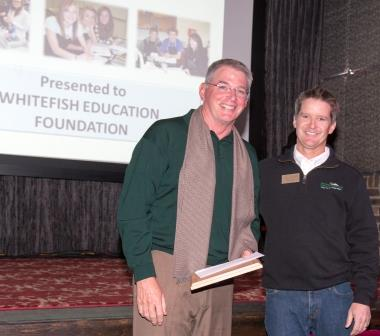 Eric Hosek of the Whitefish Education Foundation accepts the Doris Schumm Award from Doug Reed.