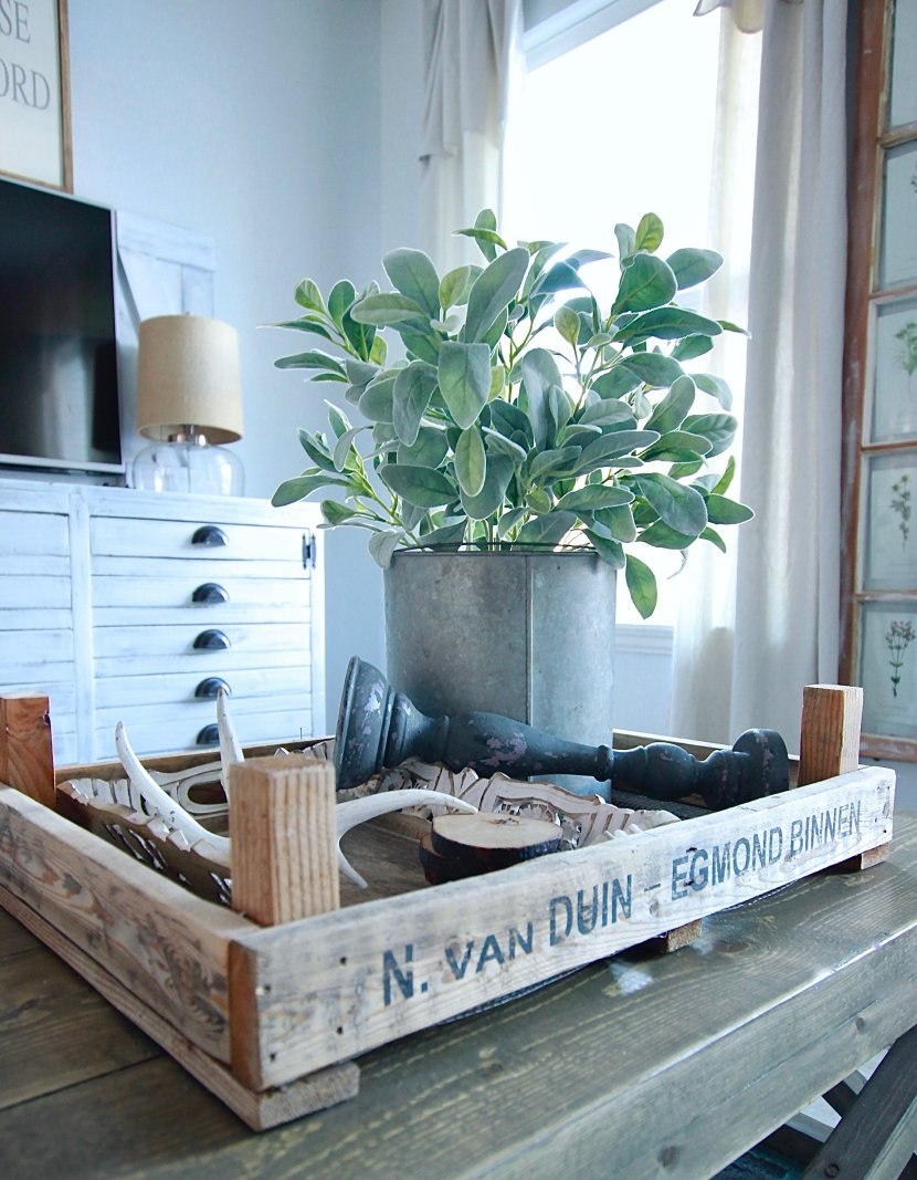 Effortless Farmhouse Centerpiece with faux sag plant, painted antlers and candlesticks and tulip tray and galvanized bins www.whitepicketfarmhouse.com