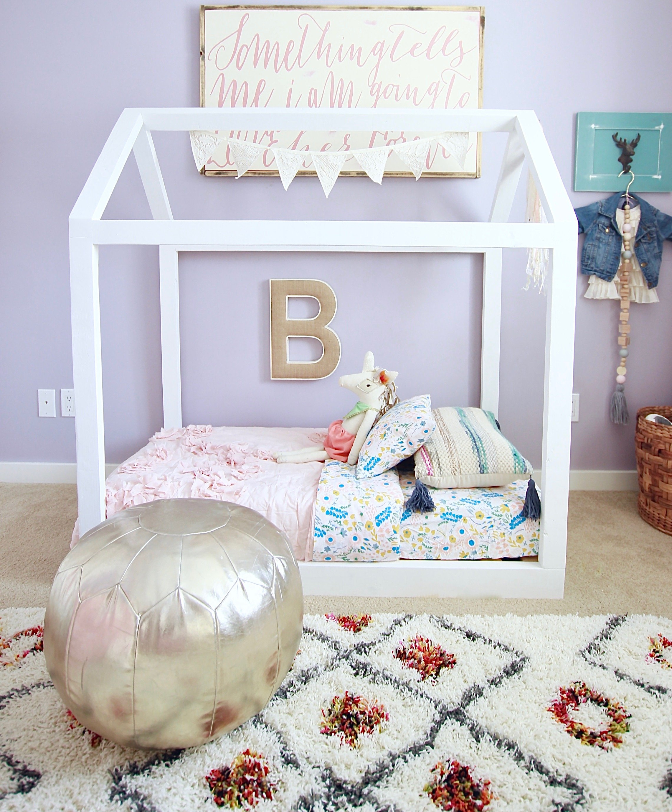 Our DIY Toddler House Bed We built for our daughter. Super easy and only takes a few hours and under 40 dollars. www.whitepicketfarmhouse.com