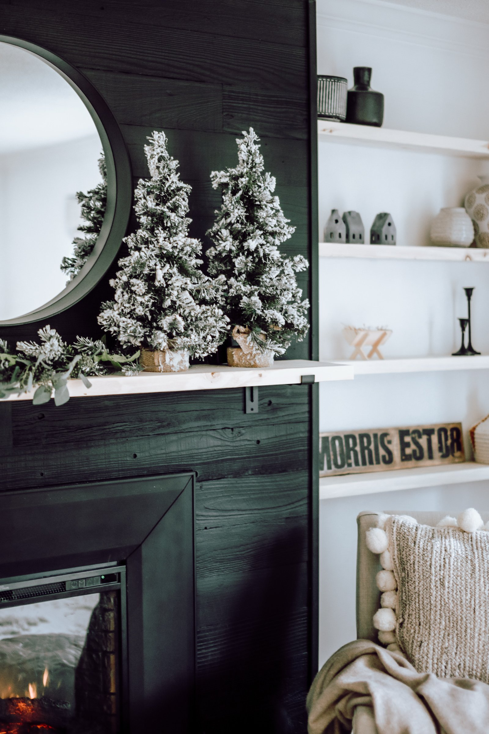 A Modern Christmas Living Room. How we decorated our living room with minimal Christmas decor using white, black and natural woods.