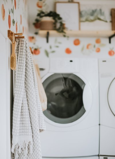 One Room Challenge - Laundry Room Makeover. How We DIY'd and Completely transformed this ugly old laundry room for under 200 dollars! Bright and Happy Laundry Room Makeover