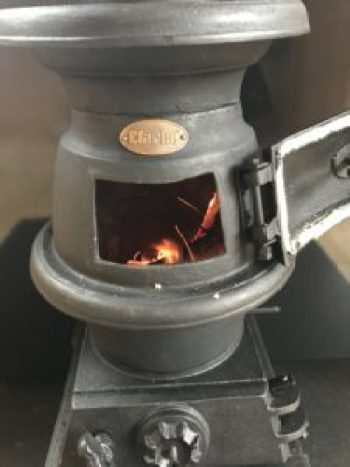 stove door open e1511799573551 225x300 - Pot Bellied Stove - a necessary addition to The Shepherds Hut