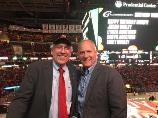 Jeff Kraft, Business Developer, and Phil Whitman enjoy a NJ Devils playoff game victory at the Prudential Center compliments of Investors Bank.