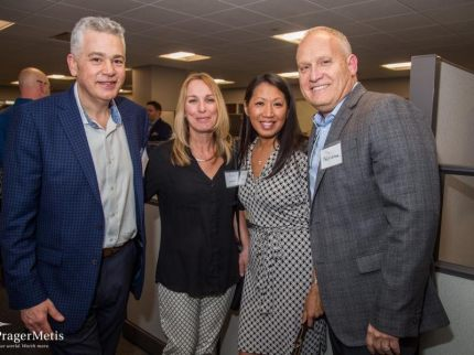 Mike Zaremski, President of PM Human Capital Solutions with Jodi Zaremski and Mia & Phil Whitman at the Prager Metis open house celebrating their new Cranbury, NJ Office.