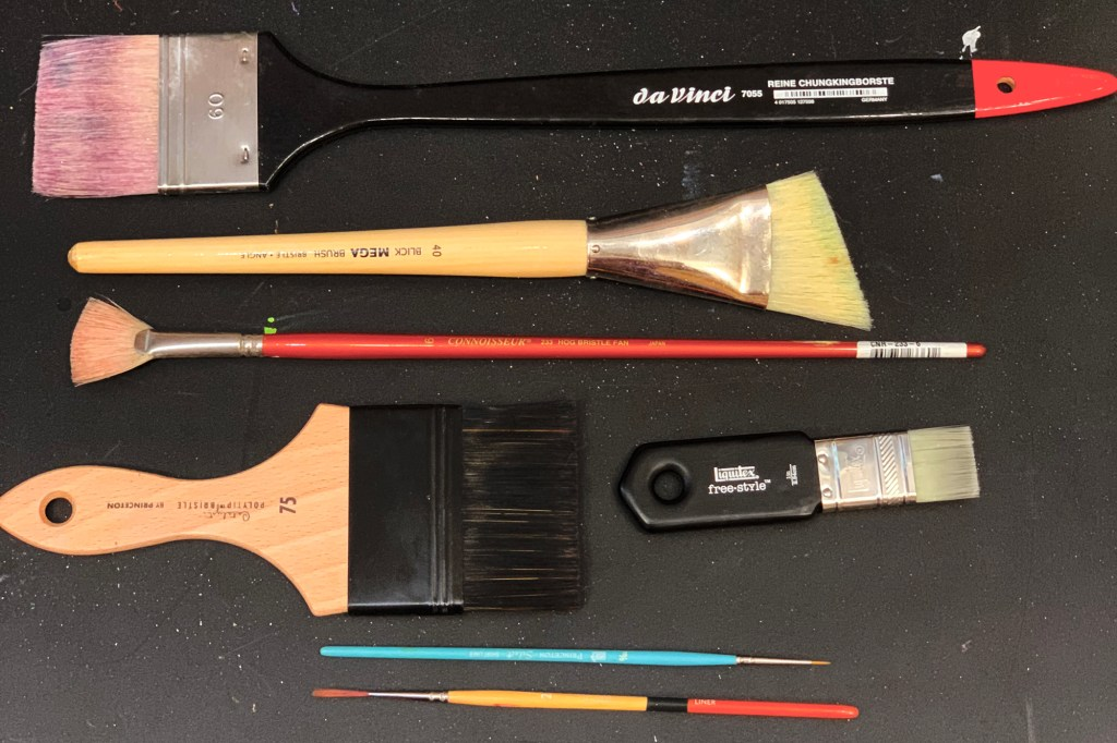 (from top to bottom) Spalter, angled flat, fan, mottler, paddle brush, short and long liner