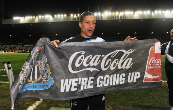 Chris Hughton celebrating Newcastle United's promotion to the Premier League