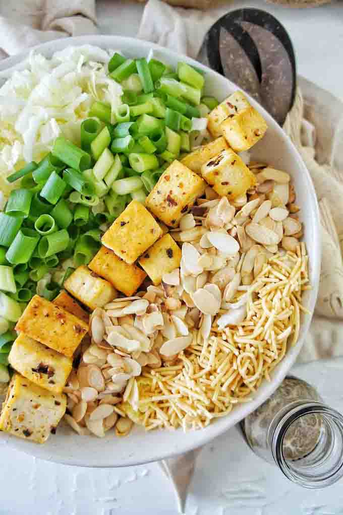 All of the ingredients for Crispy Tofu Noodle Salad in a white bowl