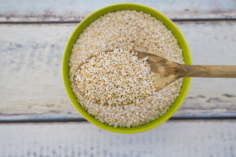 popped organic amaranth on wooden spoon and in bowl