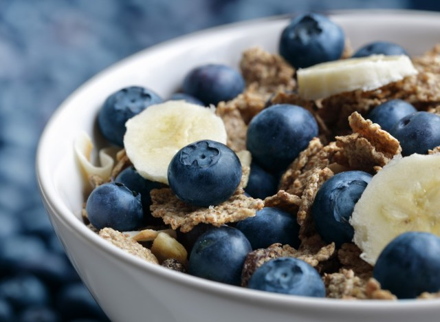 High fiber bowl with bran muesli with blueberries and bananas