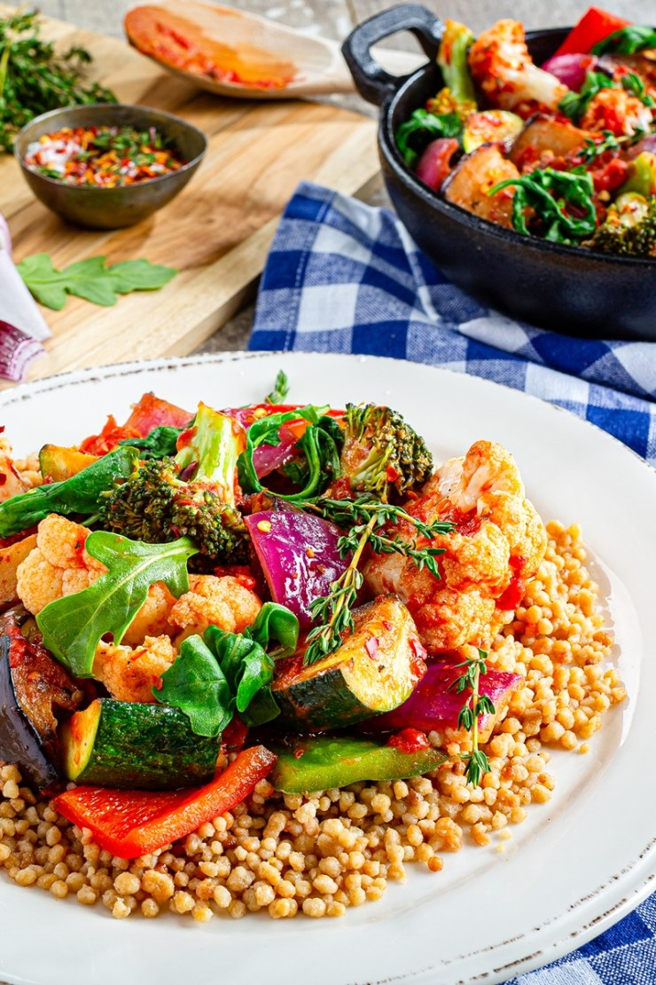 Rustic ratatouille recipe with broccoli, cauliflower and rocket over couscous (plant-based, vegan, gluten-free, dairy-free, allergy-friendly)