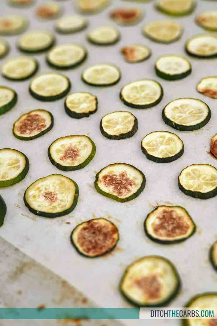 Place the zucchini slices on a parchment-lined baking sheet