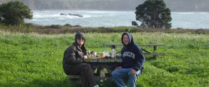 Chef Mason and anand enjoying a holistic picnic amidst a veritable field of food in Fort Bragg, CA