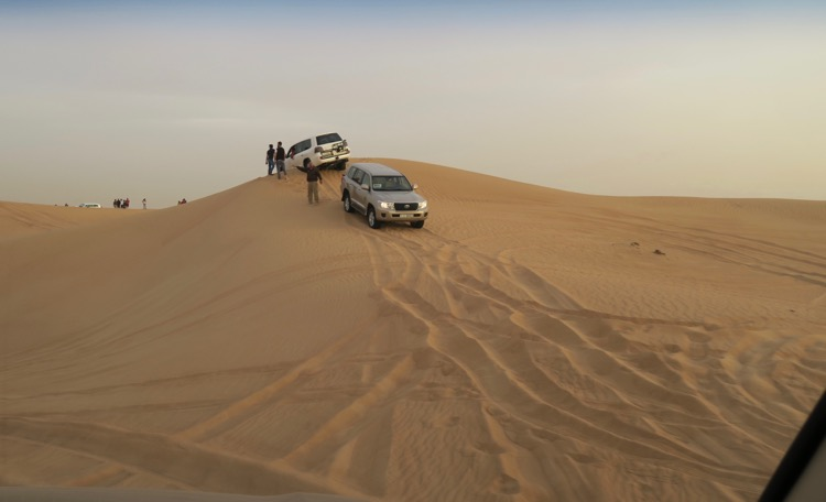car stuck in sand dune