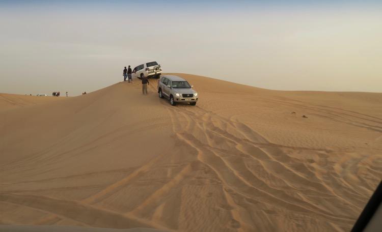 car stuck in sand dune
