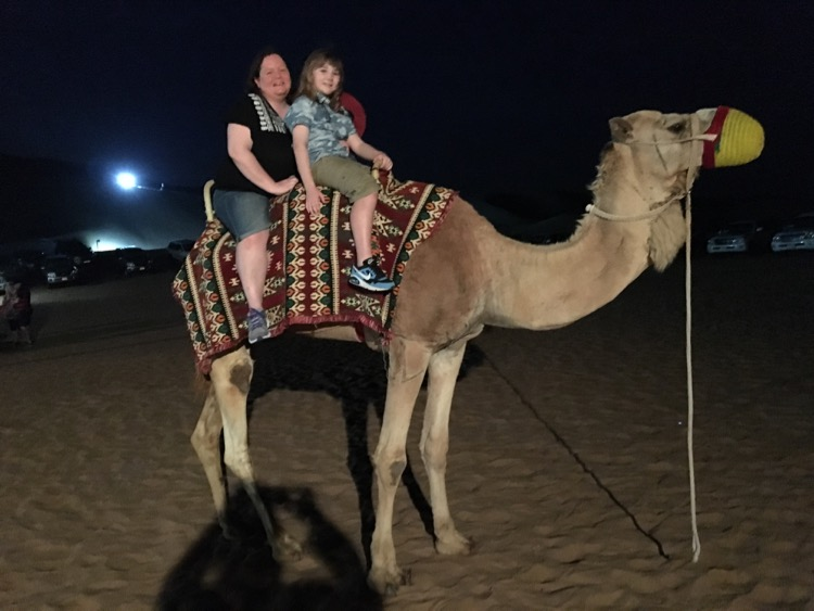 Ask the camel guide and he'll take a photo for you.