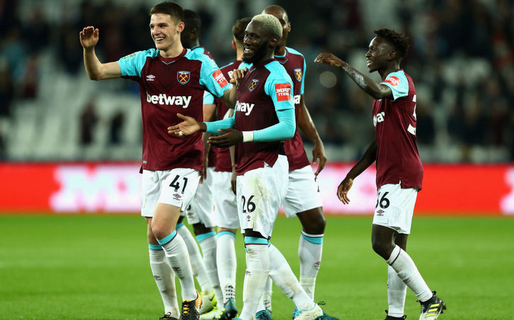 Masuaku celebrates with his teammates