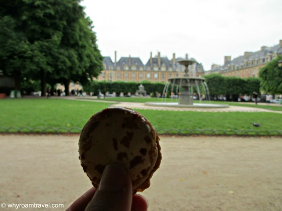 Eating macarons from Gerard Mulot in Place de Vosges in Paris | whyroamtravel.com