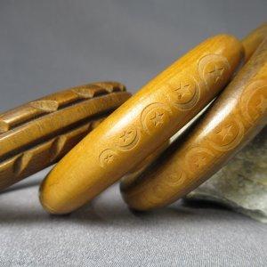 Three Carved Wood Bangles