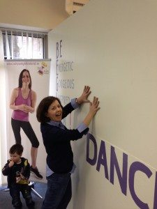 Marie adding her hand prints to the Wall of Success in Why Weight Ireland
