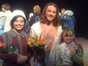 Brent Lengal and Mary Beth Warner pose with Alex following their roles as John Proctor and Abigail Williams in the Russell County Production of Arthur Miller's The Crucible on Main Street in Russell Springs.