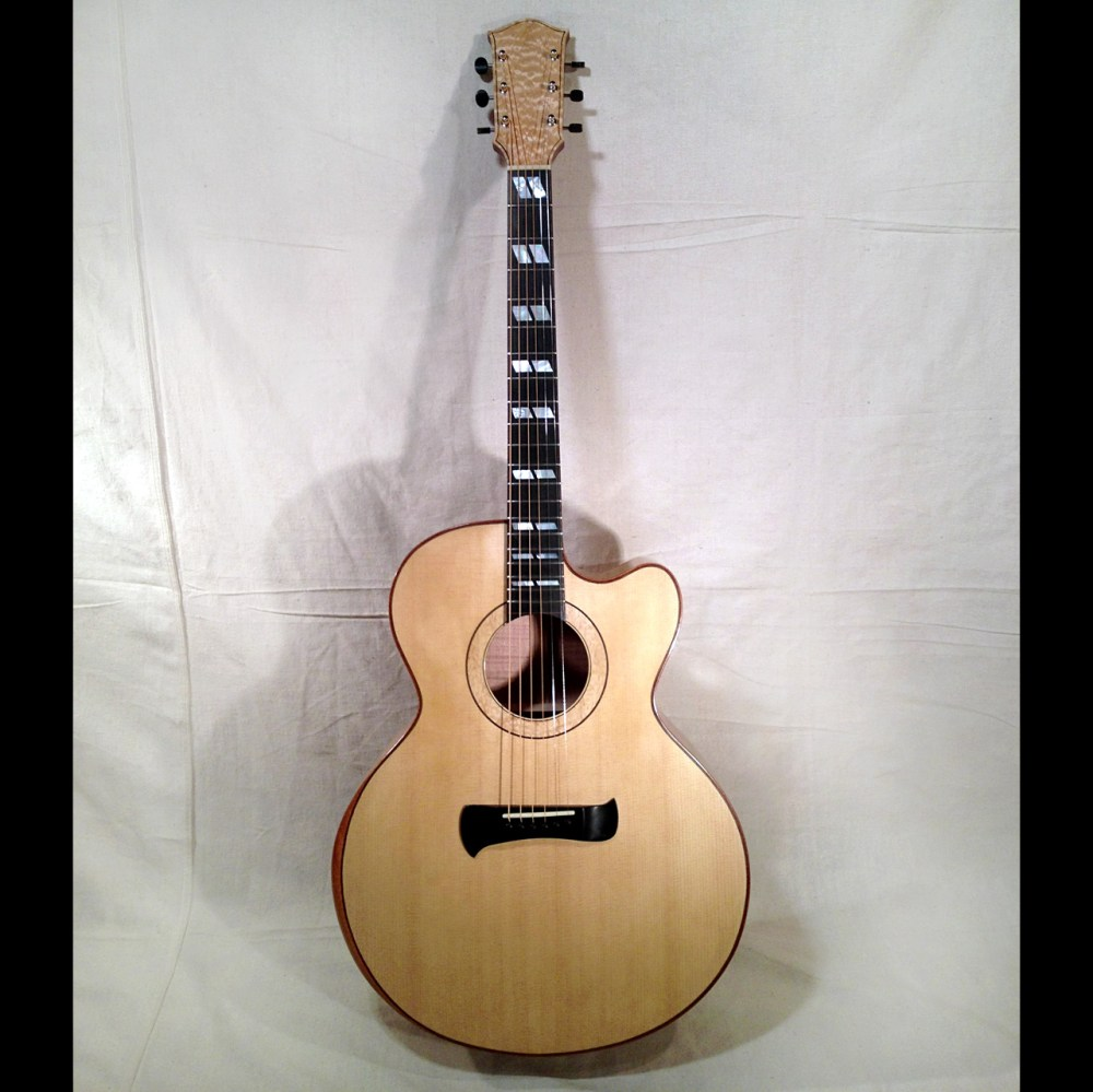 P185 a replica of the Gibson J185 with a Venetian cutaway.