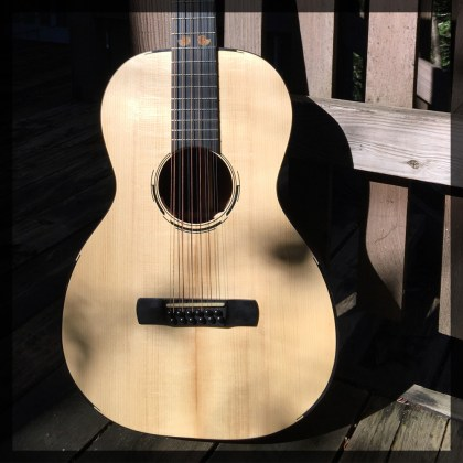 Parlor 12 string, Adirondack Spruce, Indian Rosewood back and sides. Ammonite inlay