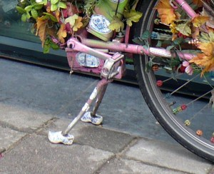 "Close Up of Fiets (bike) , with klompen (wooden shoes) on the ""feets"" . Note diminutive size of shoes. Who's crazy-talkin' 'bout elves now, hmmm?"