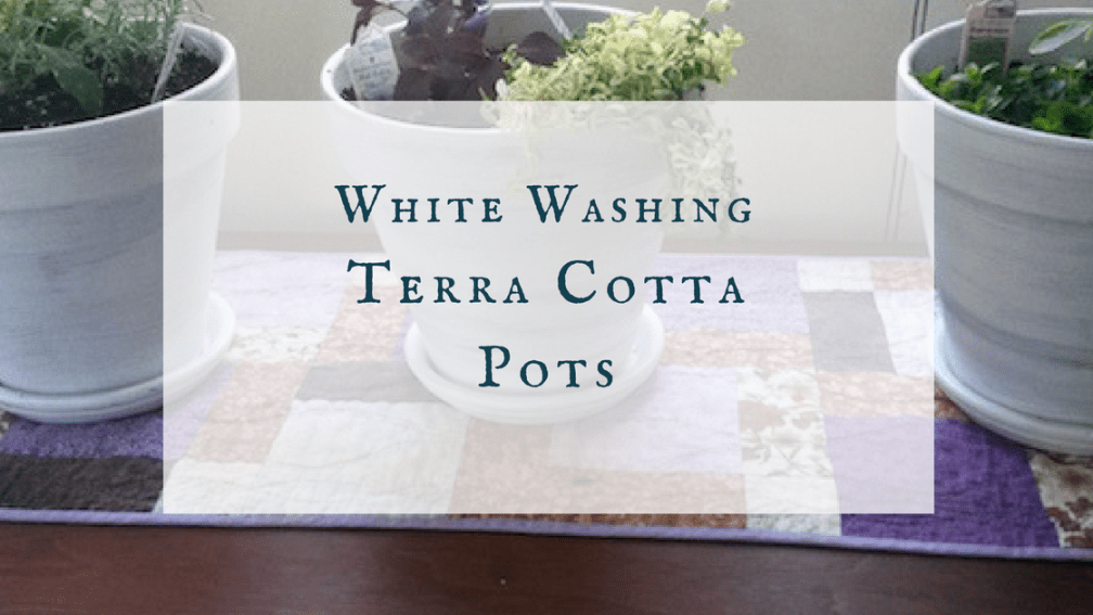 White washing terra cotta pots.