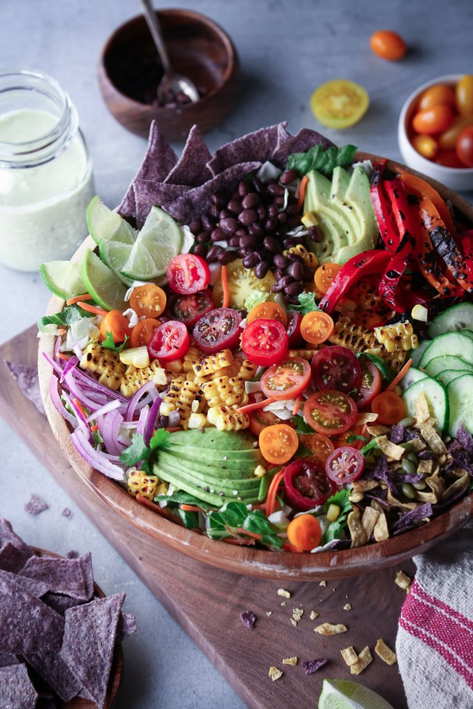 Southwestern Taco Salad | Loaded with grilled and fresh veggies, black beans, and topped with an avocado-cilantro dressing.