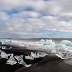 icebergs on a the black sand diamond beach on south coast of Iceland