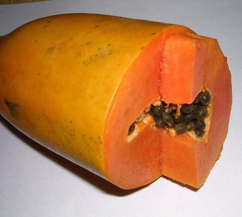 Image of cut ripe papaya with black seeds