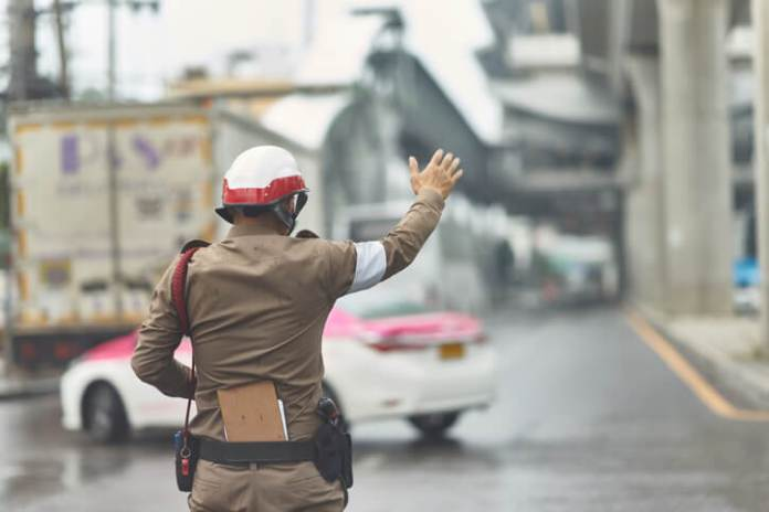 Thai traffic policeman in working action