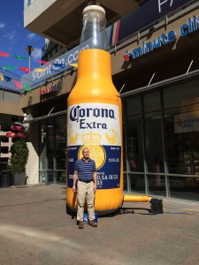 Wil poses next to a giant Corona beer bottle at the Epicenter.