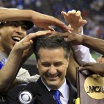 Kentucky Wildcats forward Anthony Davis messes up the hair of head coach John Calipari as he holds the championship trophy after the Wildcats defeated the Kansas Jayhawks in the men's NCAA Final Four championship college basketball game in New Orleans