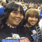 Anthony Davis's mother and sister honored his celebrated bit of facial hair during Kentucky's win Saturday night - photo by Rachel Berman