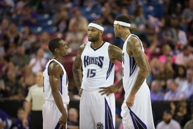 Kings guard Rajon Rondo, left, talks with center DeMarcus Cousins (15) and center Willie Cauley-Stein during their preseason game on Oct. 8 at Sleep Train Arena in Sacramento. Hector Amezcua