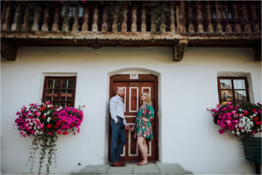 Couple standing in doorframe of old Austrian farmhouse