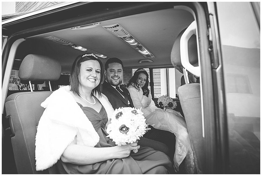 The bridal party sitting in their taxi