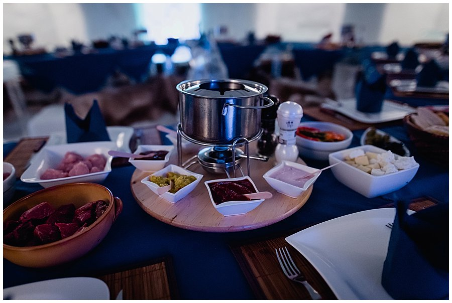 The fondue pots are prepared for the wedding breakfast in the igloo