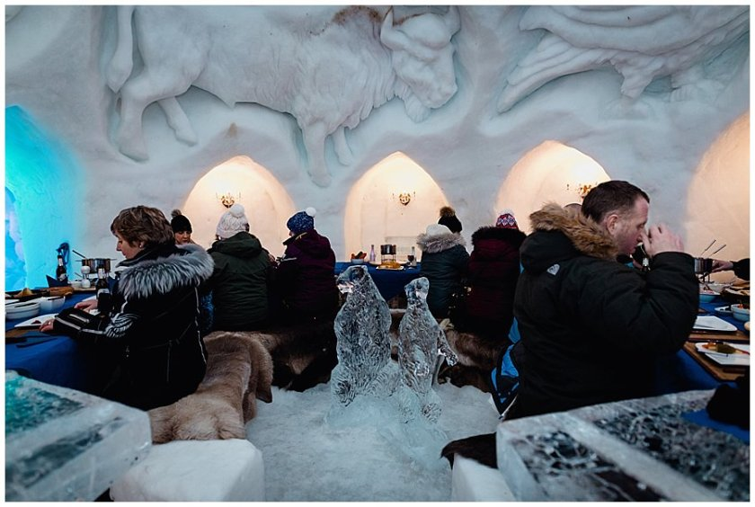 Guests take their seats at the ice table in the igloo