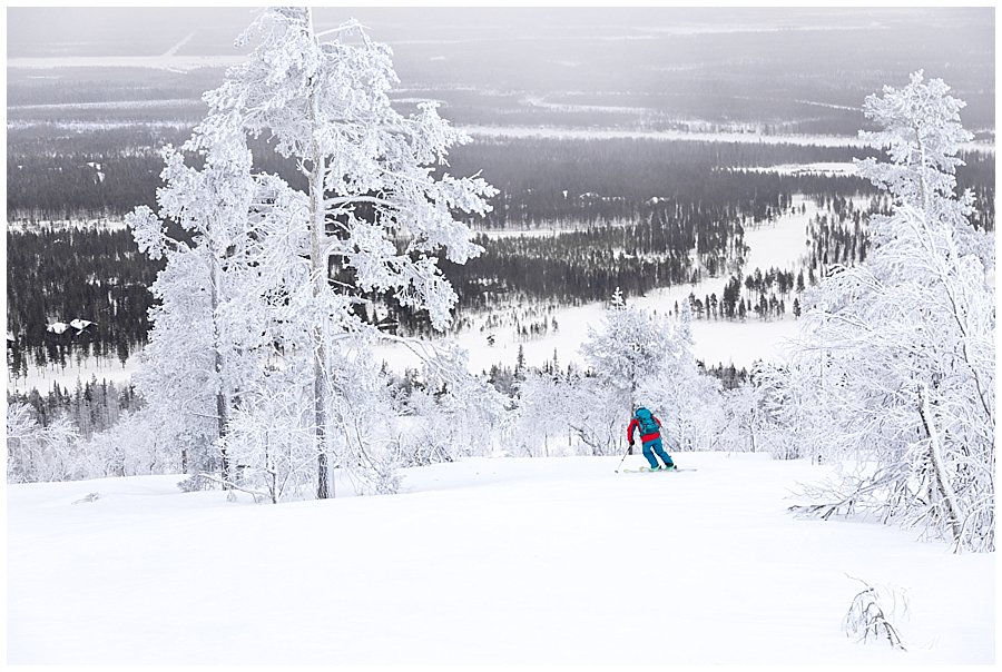 Menno skiing off-pist through the trees in Levi Finland by Wild Connections Photography