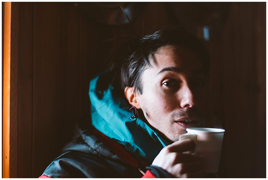 Menno warms up in the Kota with a cop of hot berry juice in Levi Finland by Wild Connections Photography