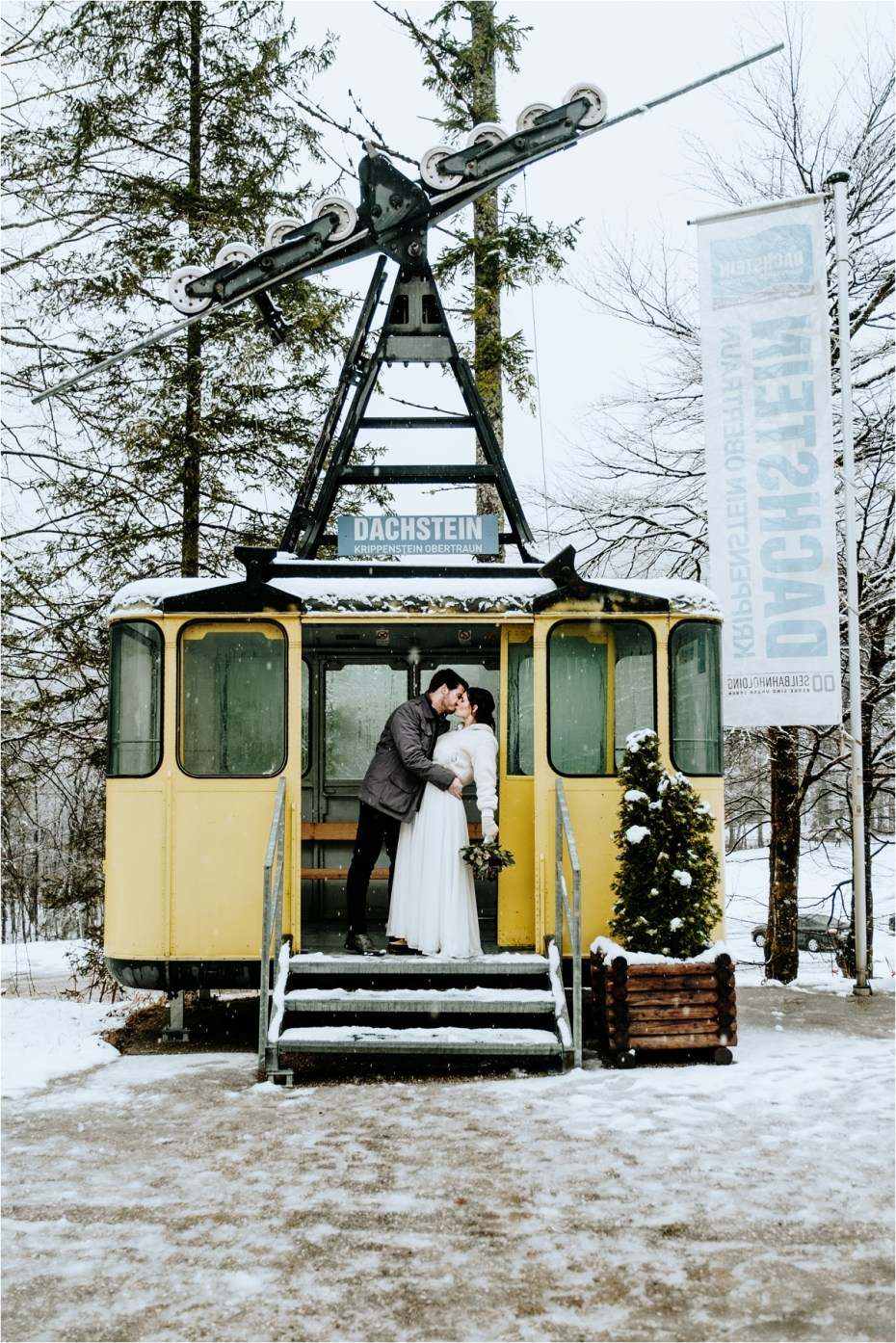 Bride and groom kiss in a vintage cable car in Hallstatt Austria after their elopement wedding. Photos by Wild Connections Photography